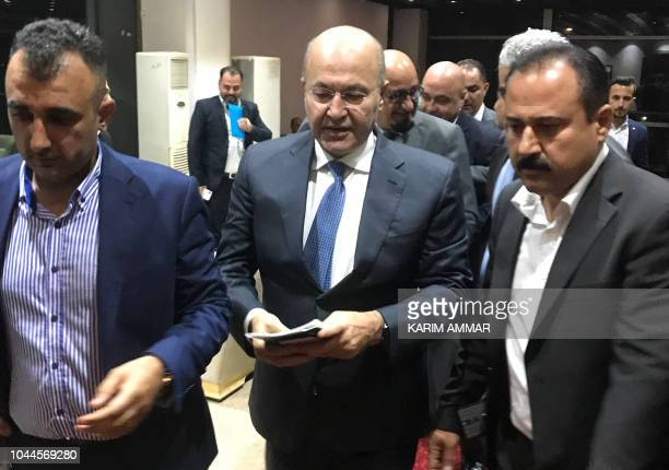 Newly elected Iraqi President Kurdish Barham Saleh walks at the parliament in Baghdad on October 2 2018 The moderate Kurdish candidate was elected...