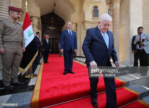Newly elected Iraqi President Kurdish Barham Saleh watches as his predecessor Fuad Masum leaves during the handing over ceremony in Baghdad on...