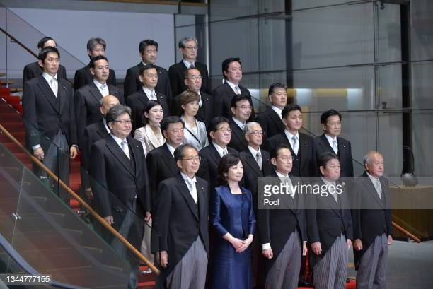 Newly elected Japanese Prime Minister Fumio Kishida poses with his cabinet members at the prime minister's official residence on October 04, 2021 in...