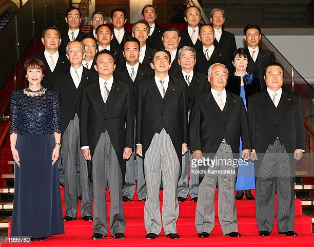 Newly elected Japanese Prime Minister Shinzo Abe poses with newlyappointed members of his cabinet after receiving an acceptance from Emperor Akihito...