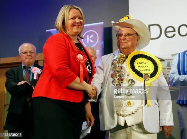 Newly elected Labour Party MP Lisa Forbes shakes hands with Official Monster Raving Loony Party candidate Alan Howling Laud Hope at the byelection...