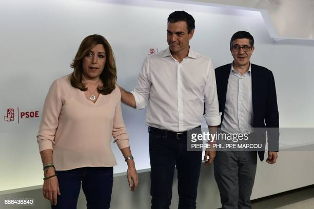 Newly elected leader and former leader of Spanish Socialist Party Pedro Sanchez stands between with fellow candidates to the party leadership...