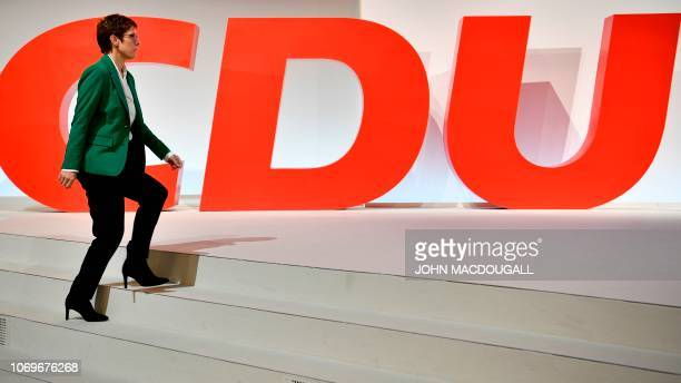 Newly elected leader of the Germany's conservative Christian Democratic Union party Annegret KrampKarrenbauer arrives on stage during the CDU...