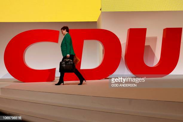 Newly elected leader of the Germany's conservative Christian Democratic Union party Annegret KrampKarrenbauer leaves the venue at the end of the CDU...
