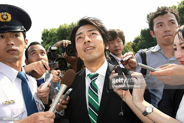 Newly elected Liberal Democratic Party lawmaker Shinjiro Koizumi looks on the diet building on arrival on September 16 2009 in Tokyo Japan