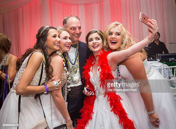 Newly elected Louisiana governor Democrat John Bel Edwards poses for a selfie with Princesses of the Ball Madelyne Sumrall Bess Ewing Rebecca Lawler...