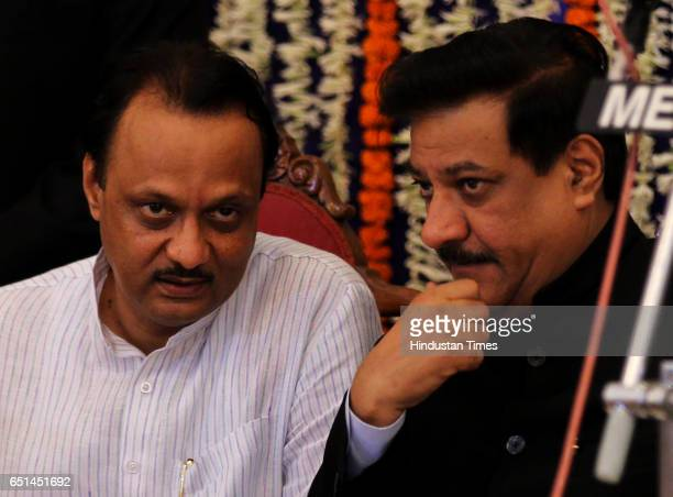 Newly elected Maharashtra CM Mr Prithviraj Chavan chats with newly elected Dy CM Mr Ajit Pawar after taking oath for their post duing the swearing in...