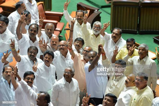 Newly elected members of the Karnataka State Legislative Assembly belonging to Congress and Janatha Dal gesture after the Chief Minister BS...