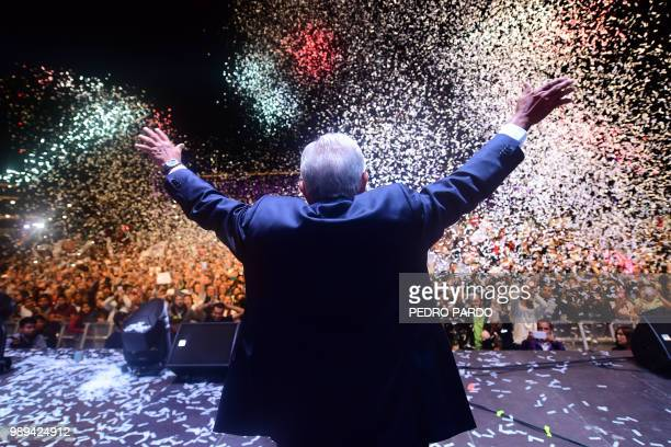 TOPSHOT Newly elected Mexico's President Andres Manuel Lopez Obrador running for Juntos haremos historia party cheers his supporters at the Zocalo...