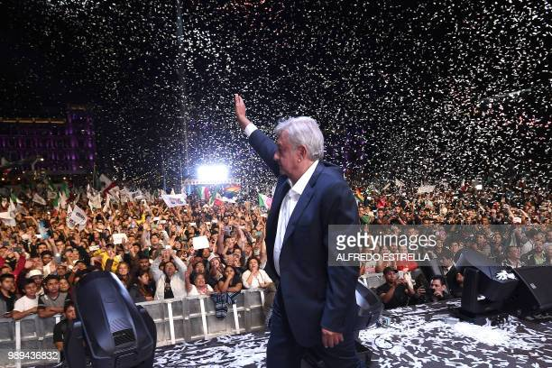 Newly elected Mexico's President Andres Manuel Lopez Obrador running for Juntos haremos historia party cheers his supporters at the Zocalo Square...