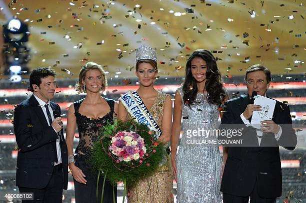 Newly elected Miss France 2015 Camille Cerf poses next to Miss France 2014 Flora Coquerel French singer and the president of Miss France 2015 jury...