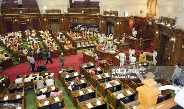 Newly elected MLAs taking oath at Vidhan Sabha in the presence of Chief Minister Yogi Adityanath on March 28 2017 in Lucknow India