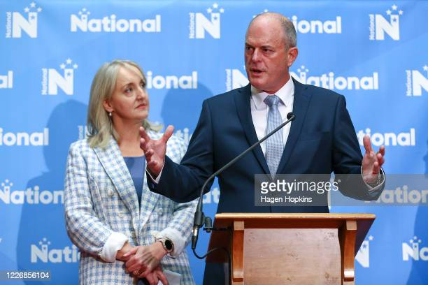 Newly elected National Party Leader Todd Muller speaks to media while Amy Adams looks on during a press conference to announce a new Shadow Cabinet...