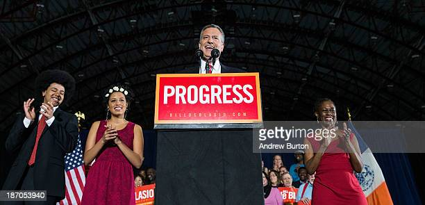 Newly elected New York City Mayor Bill de Blasio speaks on stage next to his wife Chirlane McCray and children Dante de Blasio and Chiara de Blasio...