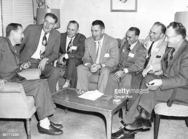 Newly elected officers and directors of the Colorado Press association talk things over during their first meeting in the Cosmopolitan hotel Shown...