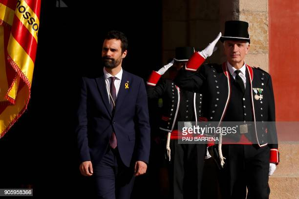 Newly elected parliament speaker Roger Torrent reviews members of the Catalan regional police force Mossos d'Esquadra after Catalan's parliament...