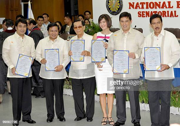 Newly elected Philippine senators Ramon 'Bong' Revilla Jnr Jose Ejercito 'Jinggoy' Estrada Juan Ponce Enrile Pia Cayetano Ralph Recto and Vicente...