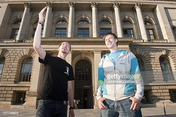 Newly elected Pirate Party lawmakers Andreas Baum and Martin Delius pose in front of the senate building in Berlin September 29, 2011. Hailed as an...