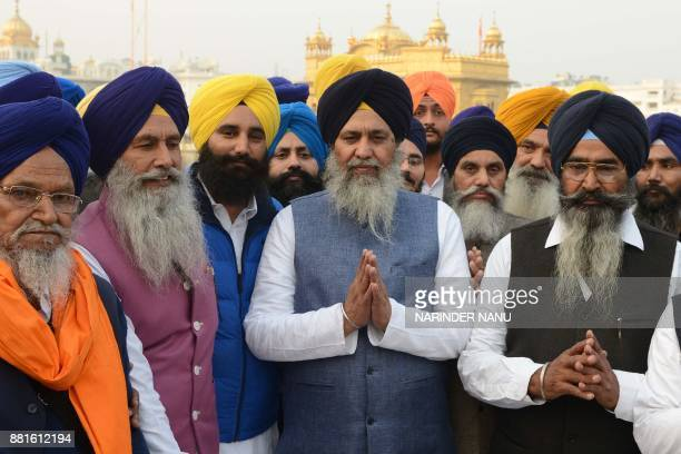 Newly elected president Gobind Singh Longowal of Shiromani Gurdwara Prabandhak Committee with supporters pay respect at the Golden temple in Amritsar...