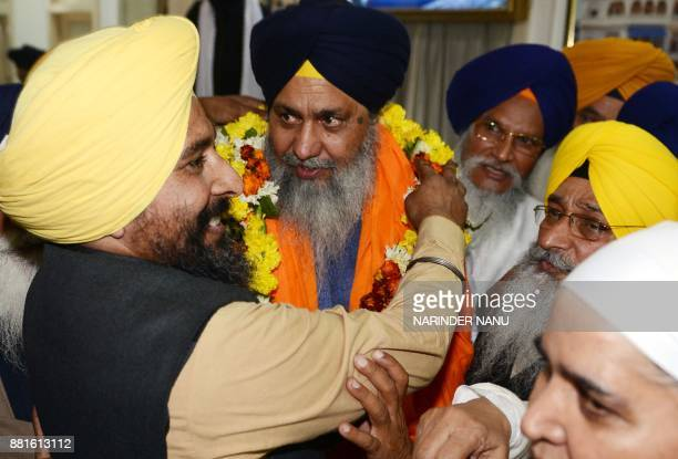 Newly elected president Gobind Singh Longowal of Shiromani Gurdwara Prabandhak Committee gestures while being garlanded by his supporters at Teja...