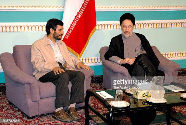 Newly elected president Mahmoud Ahmadinejad meets incumbent president Mohammad Khatami at the former diet building on June 29, 2005 in Tehran, Iran.