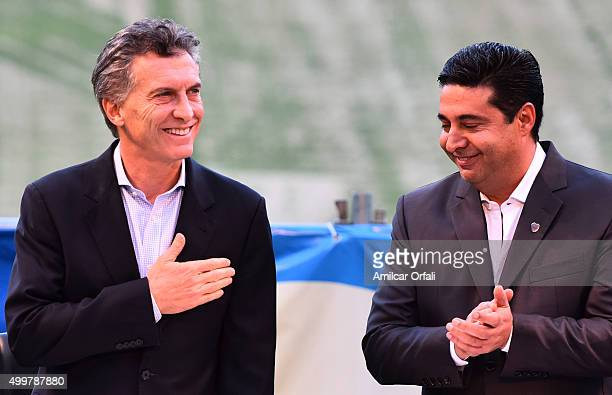 Newly elected President of Argentina Mauricio Macri and Daniel Angelici President of Boca Juniors smile during a ceremony to honor newly elected...