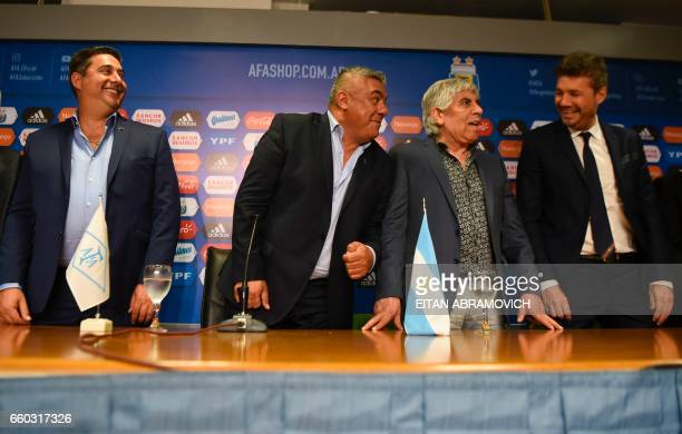 Newly elected President of Argentina's Football Association Claudio Tapia is pictured next to Boca Juniors' president Daniel Angelici Independiente's...