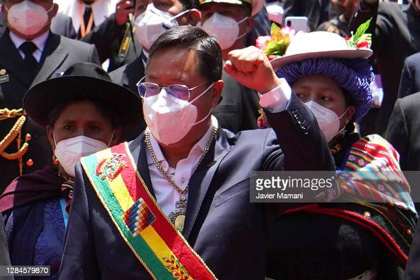 Newly elected President of Bolivia Luis Arce raises his fist after the swearing in ceremony at Plaza Murillo on November 08, 2020 in La Paz, Bolivia.
