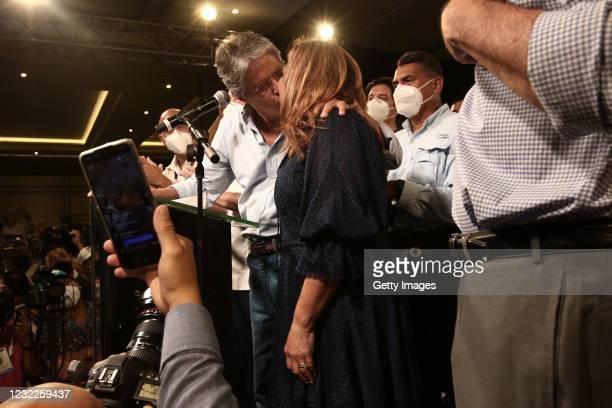 Newly elected President of Ecuador Guillermo Lasso kisses his wife María de Lourdes Alcívar Crespo after winning the presidential runoff against...