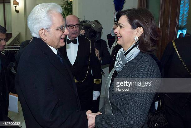 Newly elected President of Italian Republic Sergio Mattarella shakes the hand of President of the Chamber of Deputies Laura Boldrini at Quirinale on...