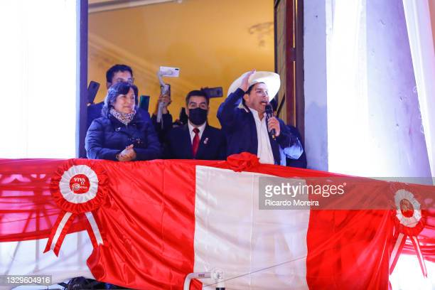 Newly Elected President of Peru Pedro Castillo speaks next to his running mate Dina Boluarte during a celebration after being confirmed as new...