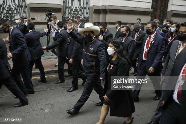 Newly elected President of Peru Pedro Castillo walks towards Congress along his wife Lilia Paredes ahead of the presidential inauguration on July 28,...