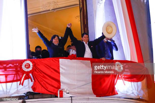 Newly Elected President of Peru Pedro Castillo waves supporters with his running mate Dina Boluarte during a celebration after being confirmed as new...