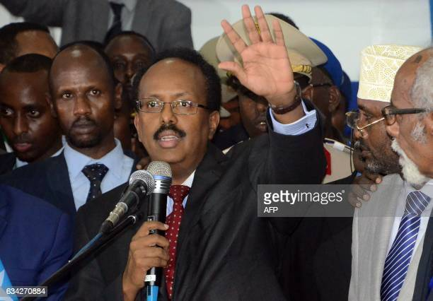 Newly elected President of Somalia and former prime minister Mohamed Abdullahi Farmajo gestures as he makes an address on February 8 in Mogadishu...