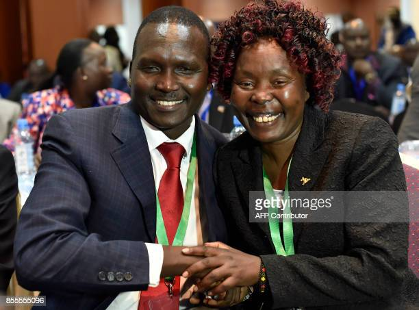 Newly elected president of the National Olympic Committee of Kenya Paul Tergat is congratulated by Kenyan longdistance runner Tegla Loroupe after his...