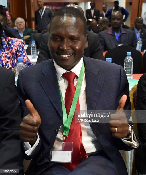 Newly elected president of the National Olympic Committee of Kenya Paul Tergat celebrates after his election in Nairobi on September 29 2017 The...
