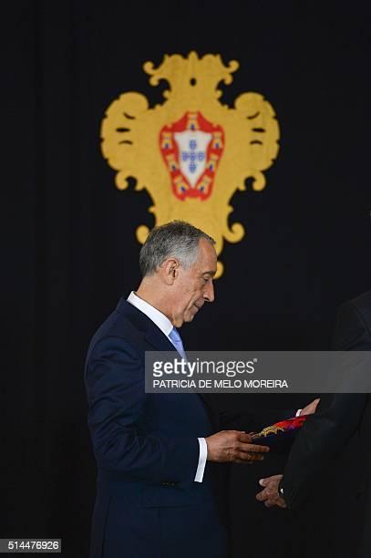 "Newly elected President of the Portuguese Republic Marcelo Rebelo de Sousa receives a Portuguese honorific order ""Banda das três ordens"" at Belem..."