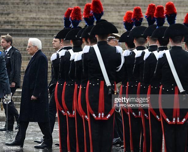 Newly elected President, Sergio Mattarella and Italian Prime Minister Matteo Renzi arrive to lay a wreath at the Altare della Patria on February 3,...