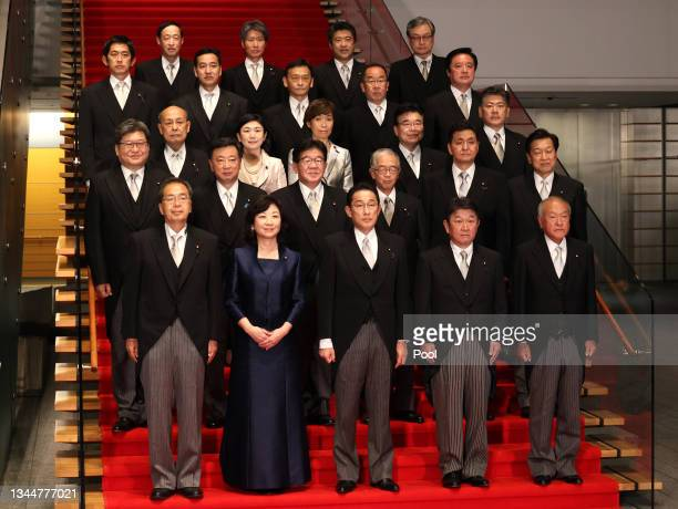 Newly elected Prime Minister Fumio Kishida arrives with his cabinet members at a photo session at the prime minister's official residence in Tokyo on...