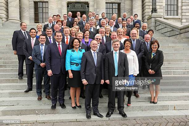 Newly elected Prime Minister John Key and Deputy Prime Minister Bill English pose during the National Party team photo at Parliament House on...