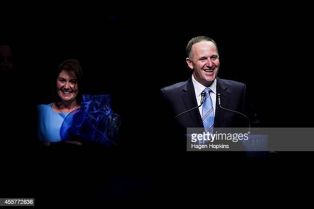 Newly elected Prime Minister John Key delivers his victory speech while wife Bronagh Key looks on at Viaduct Events Centre on September 20 2014 in...