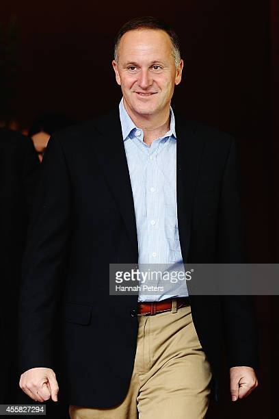Newly elected Prime Minister John Key leaves after speaking to the media on September 21 2014 in Auckland New Zealand Last night National Party...