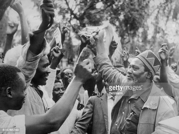 Newly elected Prime Minister Jomo Kenyatta joins in victory celebrations here on May 28th after his Kenya African National Union won 62 out of 112...
