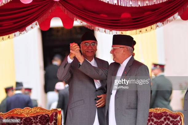 Newly elected Prime Minister of Nepal Sher Bahadur Deuba shake hand with Formal Prime Minister of Nepal KP Oli after taking an oath at the Sheetal...