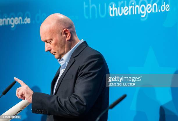 Newly elected Prime Minister of Thuringia Thomas Kemmerich of the Free Democratic Party checks the microphone before addressing a press conference at...