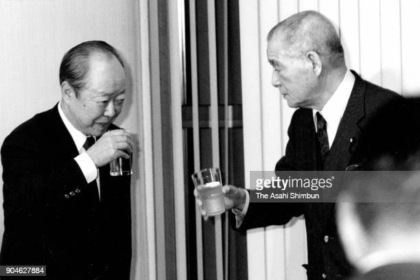 Newly elected ruling Liberal Democratic Party President Kiichi Miyazawa and Shin Kanemaru toast glasses after winning the presidential election on...