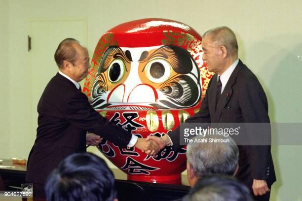 Newly elected ruling Liberal Democratic Party President Kiichi Miyazawa and Shin Kanemaru shake after winning the presidential election on October 27...