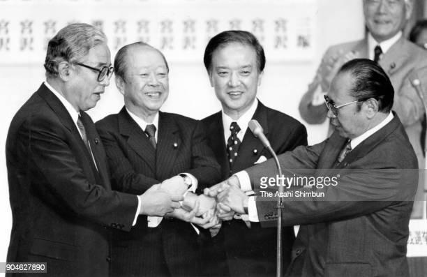 Newly elected ruling Liberal Democratic Party President Kiichi Miyazawa shake hands with defeated candidates Hiroshi Mitsuzuka Michio Watanabe and...