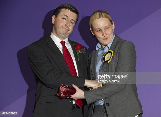 Newly elected Scottish National Party member of parliament Mhairi Black Britain's youngest member of parliament since 1667 greets Labour candidate...