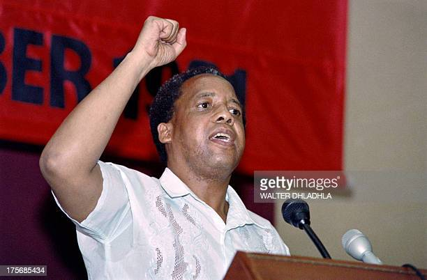 Newly elected secretary general of South African Communist Party Chris Hani salutes delegates at the closure of their first congress inside South...